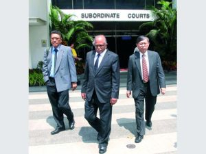Committee of Inquiry members exiting the State Courts